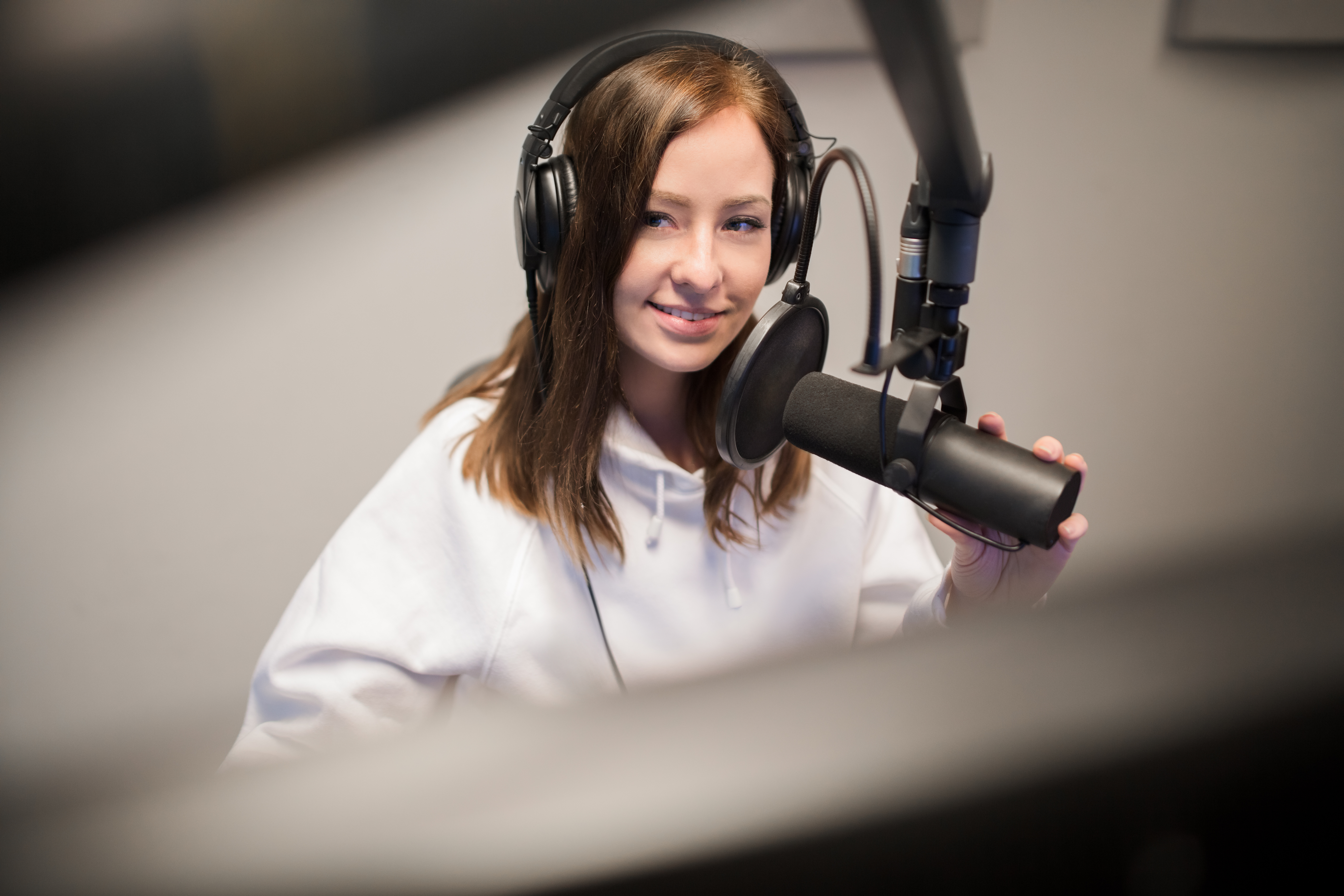 A girl recording a podcast